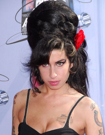 Singer Amy Winehouse looked like the offspring between Elvira and Frankenstein at the MTV movie awards