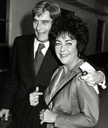 With husband #7, actor-turned-politician John Warner.